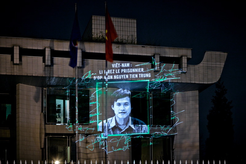 Nguyen Tien Trung, depicted here, was adopted by Amnesty International France, and his image was projected onto the Vietnamese Embassy in Paris late last year