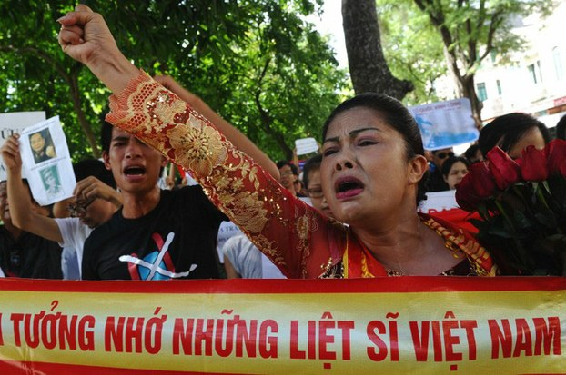 Photo of Bui Thi Minh Hang from 2011, from Radio Free Asia and AFP