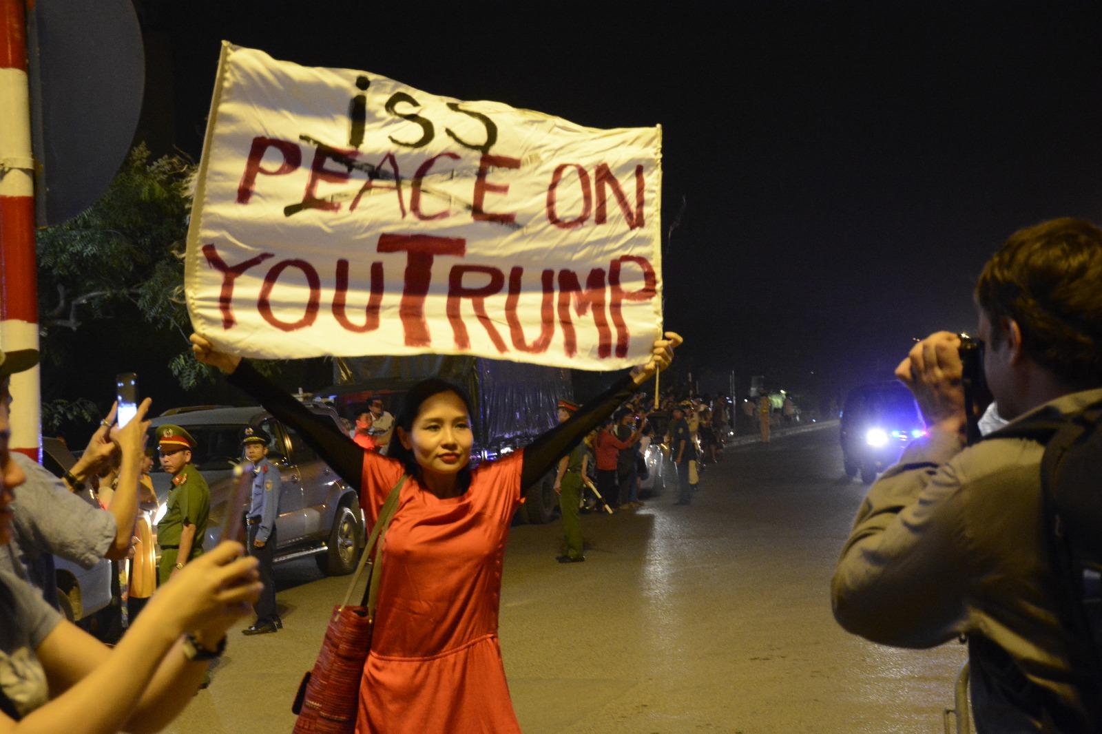 Mai Khoi and Trump banner